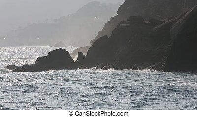 Big surf waves on Vernazza stony coast, Cinque Terre, Italy...