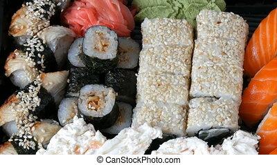 Big sushi set with variety of sushi rolls, maki, nigiri,...