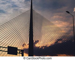 Big suspension bridge tower at sunset