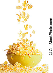 Flying to the bowl corn flakes isolate on white