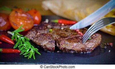 big tasty steak on stone plate - big tasty steak medium rare...