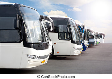 tourist buses on parking - big tourist buses on parking
