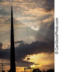 Big tower suspension bridge silhouette at sunset