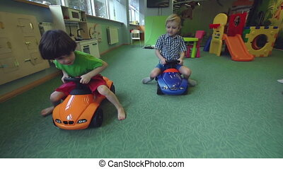 Big Toy Cars - Tracking shot of two little boys...