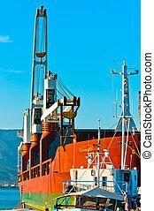 Big transportation boat at the bay against blue sky