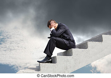 Image of pensive businessman sitting on stairs against thunderclouds