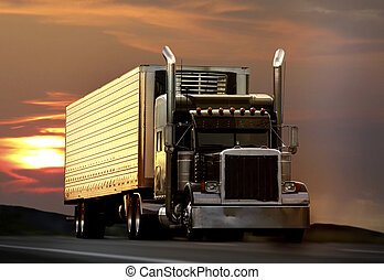 truck - big truck driving on a highway with sunset in ...