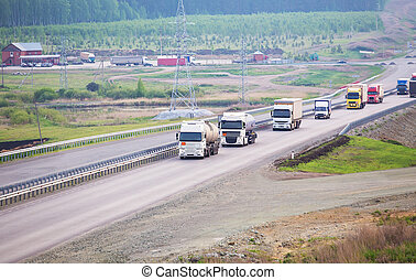 trucks go on the country highway