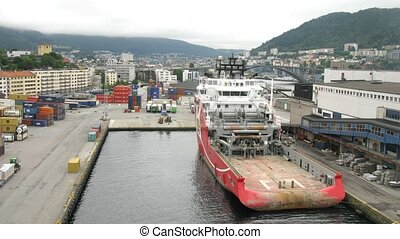 Big tugboat stationed in port in Norway, overview, time...