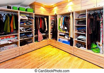 Big built in wardrobe room with open shelves