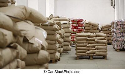 Big warehouse with bags at the factory of macaroni - Big...