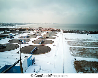 Group of building and big sedimentation drainages. Water recycling, settling, purification, by biological organisms, water station. Solid Contact Sludge Recirculation, Water Treatment plant . Winter