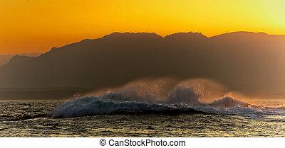 Big wave at sunset