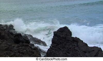 big wave crushing lava coast slowmo