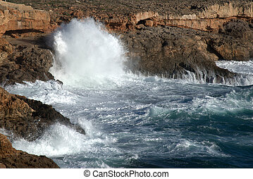 big waves breaking on rocks