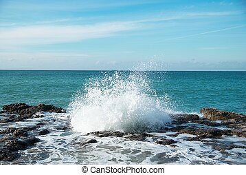Big waves breaking on the shore