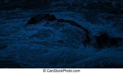 Big Waves Crash Over Rock In The Ocean At Night