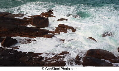big waves crashing on stone beach - big waves crashing on a...