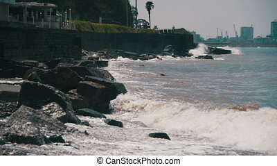 Big Waves Crashing on Stone Beach. Slow Motion in 96 fps....