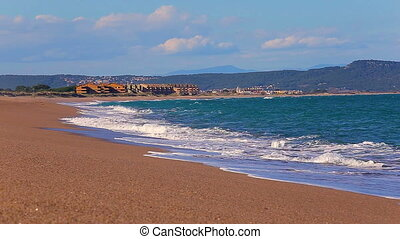 Big waves in a sunny day in Pals, Costa Brava, Spain