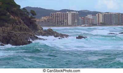 Big waves in a windy, cloudy day in Costa Brava, village Sant Antoni de Calonge, in 4K, Spain