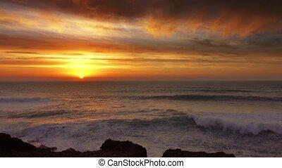 Big waves of Atlantic ocean and sunset sun, 4k
