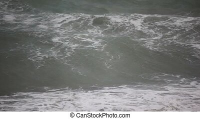 big waves of dark sea in storm, dull weather