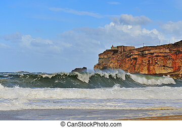 Big waves on the beach of Nazare
