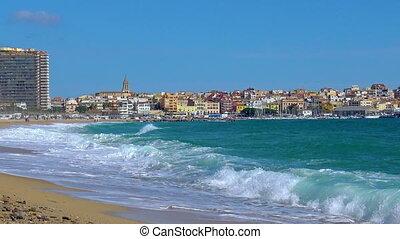 Big waves on the Spanish coastal near small town Palamos