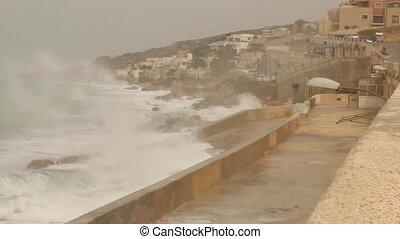 Big waves splashing on the sea dock rainny and windy...