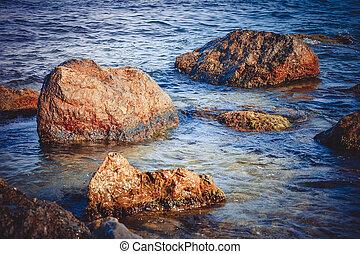 big wet stones in the water