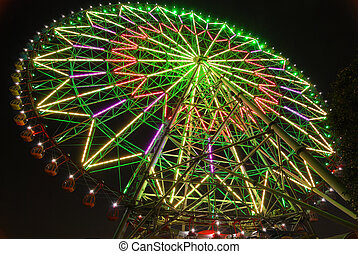 colorful details of giant ferris wheel over dark night sky background, Tokyo, Japan