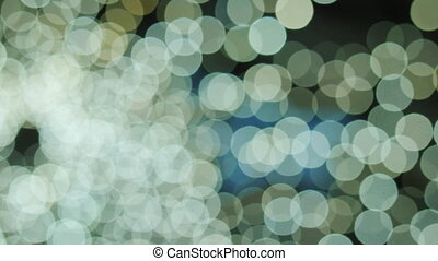 Big white and yellow bokeh background. Yellow defocused circular facula. Natural Floating Organic Abstract Particles On Black Background. Glittering Particles With Bokeh