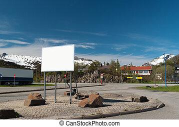 Big white bilboard on norwegian road in sunny day