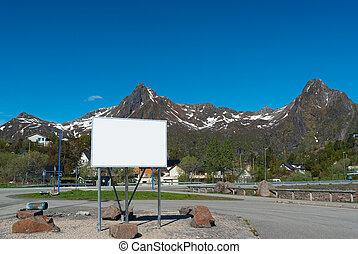 Big white bilboard on the norwegian road in sunny day