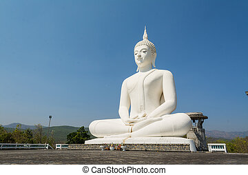 Big white buddha statue on the mountain ,temple in Tak province, Thailand.