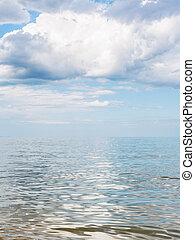 big white cloud over calm water of Azov Sea, Temryuk bay,...