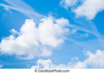 big white clouds in blue summer sky