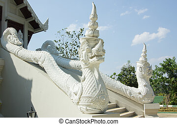 big white snake statue and handrail of a temple in Thailand