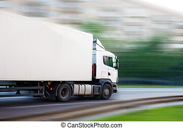 truck goes on the city street - big white truck goes on the ...
