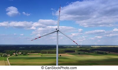 Full shot of wind energy converter for electric power production on blue sky. Aerial view