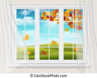 Big window with a view of the autumn landscape.