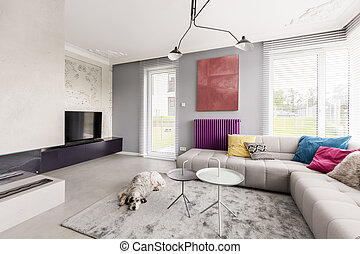 Big windows and beige couch - Spacious and bright interior...