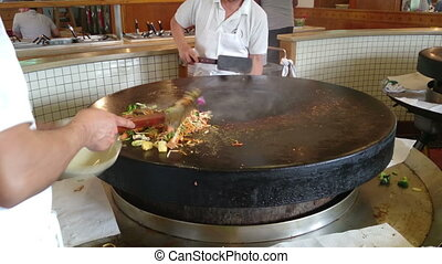 Big wok mongolian bbq with large pan, meat and vegetables