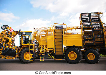 big yellow agricultural truck