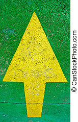 Big yellow arrow pointing up with green background