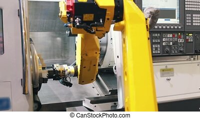 Big yellow CNC machine connects its two parts. Mid shot