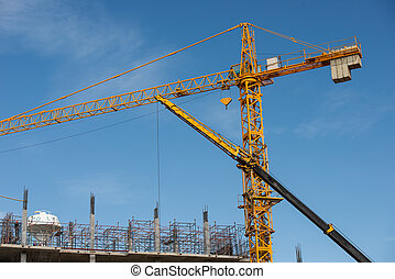 Big yellow crane in constuction site