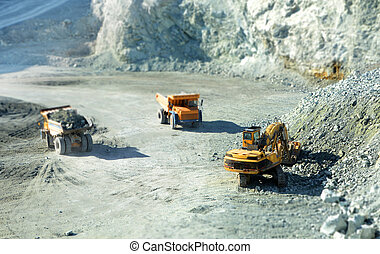 Big yellow trucks in quarry