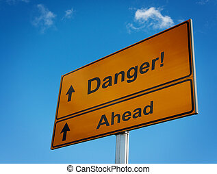 Big yellow warning road sign Danger.